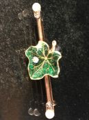 Gold (High Carat) Enamelled Maple Leaf set with small old mine cut diamond and set on a bar brooch