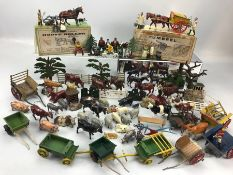 Collection of lead farmyard toys to include farm animals, figures, carts, fencing and trees etc,