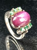 Large Cabochon Oval star Ruby ring with tourmaline stones to the shoulders