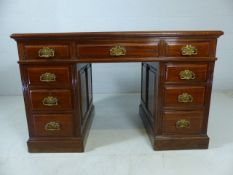 Pedestal desk with green leather top and three drawers under