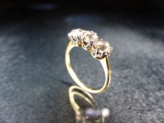 18ct Gold Three stone Diamond ring. Three Old Cut Diamonds approx .33 ct each set in white gold size