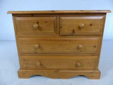 Low pine chest of four drawers