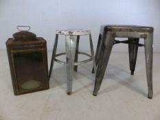 Vintage metal storm lantern and two metal stools