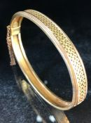 Gold Bangle unmarked but tests as Gold, with Gold wire work to half the bangle and plain to the