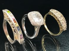 Three Silver rings of differing modern styles