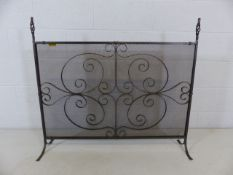 Wrought iron fire guard with decorative design
