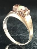 9ct Gold marked 375 ring with central Opal flanked by Diamonds size 'M'
