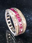 Metamorphic ring with diamond shoulders hinged to flank either a channel of square cut Ruby's or a