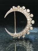 Horse shoe brooch encrusted with diamonds on white Gold