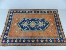 Blue and coral patterned ground rug approx. 182cm x 260cm