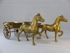 Pair of ornamental horses pulling carts