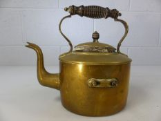 Brass kettle with tuned wooden handle