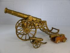 Three brass cannons, largest approx. 20cm high