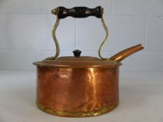 Copper kettle with turned wooden handle