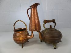 Two copper kettles and a copper jug