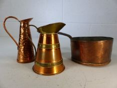 Two miniature copper and brass jugs and an antique copper saucepan