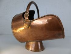Copper coal scuttle on single foot with two handles. Weight approx 3kg
