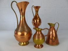Collection of four copper and brass jugs