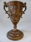 Copper twin handled chalice with cherub decoration approx. 23cm in height