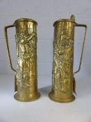 Pair of brass steins with embossed cavaliers