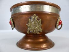 Copper twin-handled dish / bowl with raised design. Approx 7cm in height
