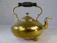 Brass teapot on three bun feet