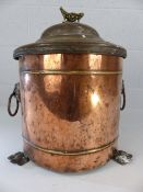 Brass and copper antique coal bin with original liner on lions feet with lion handle decoration