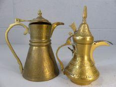 Two small Turkish brass coffee pots approx. 16cm tall