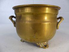 Small brass pot on ornate tripod feet