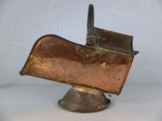 Antique brass coal scuttle on single foot of angular design. Total weight approx 4.4kg