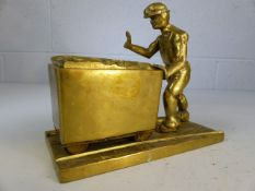 Brass figurine of miner pushing a trolley of coal approx 4.3kg and 19cm tall