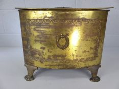Brass lidded coal box with original liner on four feet approx. 31cm tall