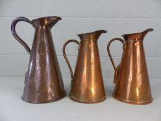 Three copper jugs