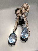 Pair of Aqua Marine and Diamond Drop Earrings. Set in white metal (unmarked) and with an approx:
