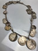 Hallmarked silver chain and Albert with a collection of various silver coloured coins total weight