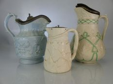 Three German stoneware jugs with relief design and pewter lids (A/F)