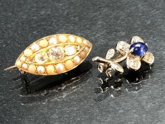 Two Small Child's Brooches: (One) 18K single flower measuring approx: 18.65mm x 10mm, with an