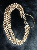 9ct Gold curb link double chain bracelet, each link hallmarked (approx 29.4g)
