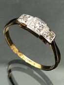 18ct yellow Gold ring with three diamonds set in platinum star shaped mounts (size K UK)