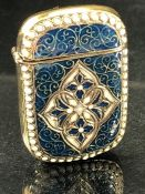 Brass and enamel set vesta case