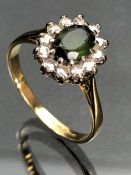 18ct yellow gold ring with large Oval faceted Peridot surrounded by twelve Diamonds (size 'Q' UK)