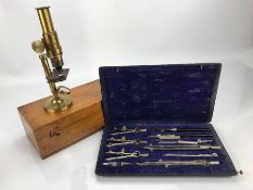 Vintage boxed microscope and a vintage compass set