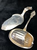 """Rare continental silver sugar sifter spoon in the shape of a Walnut marked """"K-90"""" and a small cake"""