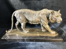 A Japanese style bronze figure of a tiger on marble base 46cm long overall