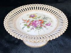 Cake stand with pierced rim and base with floral design to centre and base marked with blue