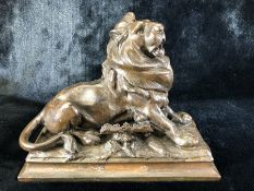 Bronzed lion inkwell with ornate pen holder with signature to base