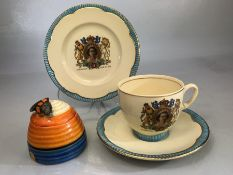 Clarice Cliff beehive honey pot (A/F) along with a Clarice Cliff Elizabeth II Coronation three piece