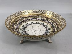 Ceramic Bowl with pierced decoration and on three Gilt painted feet marked Dresden 07