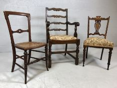 Three chairs - one oak carver, one rush-seated bedroom chair and an Edwardian upholstered chair with