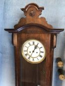 A mahogany-cased Vienna regulator wall clock, height 122cm approx with weights and pendulum
